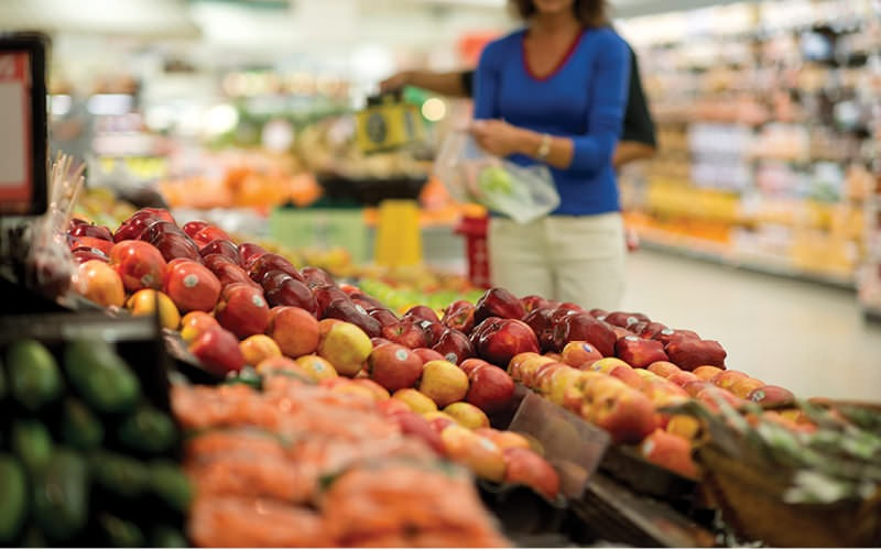 Lifestyle image of woman grocery shopping